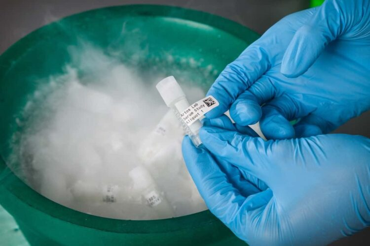 Labeled vial is placed into a vat of liquid nitrogen.