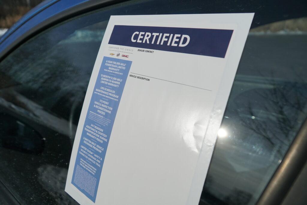 monroney sticker on outside of car window