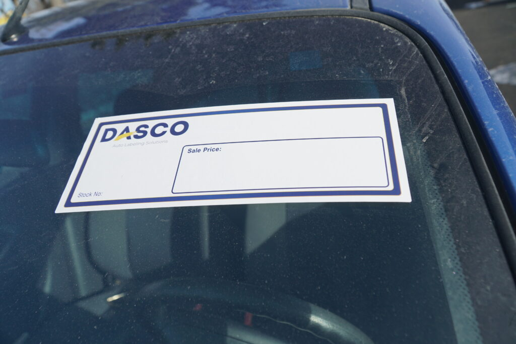 Price tag sticker on car window
